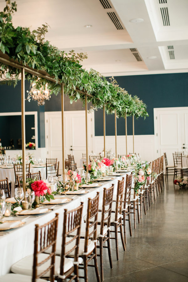 red and greenery wedding reception table