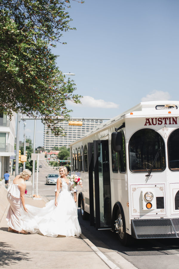 bride getting on a city bus