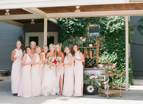 bridesmaids on champagne drink cart