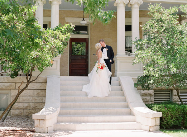 wedding kiss on the stairs