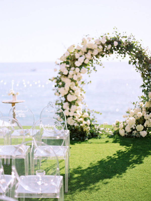 white round wedding arbor and white clear chairs | It Girl Weddings