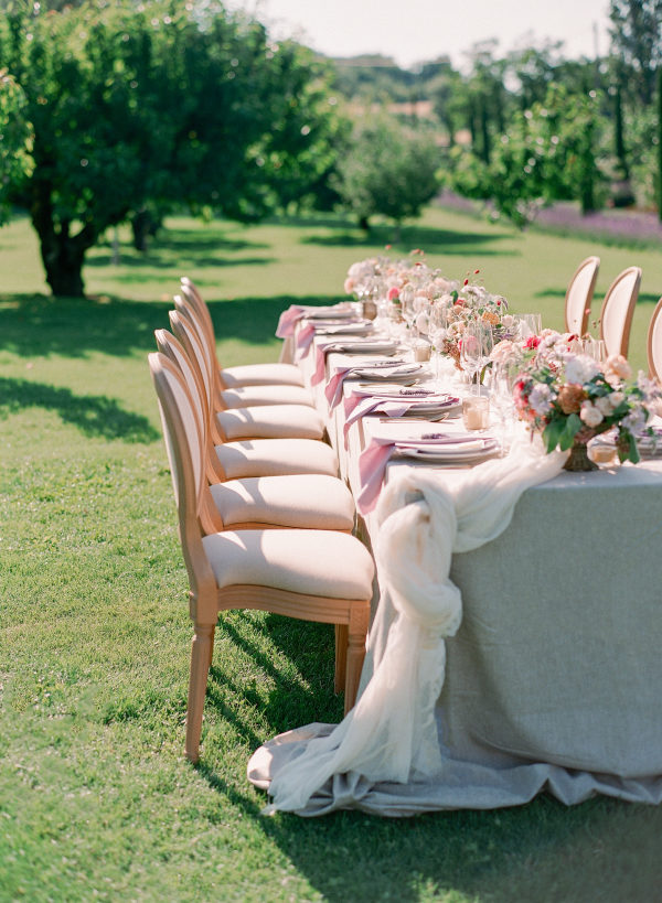 romantic wedding reception table with florals and tulle
