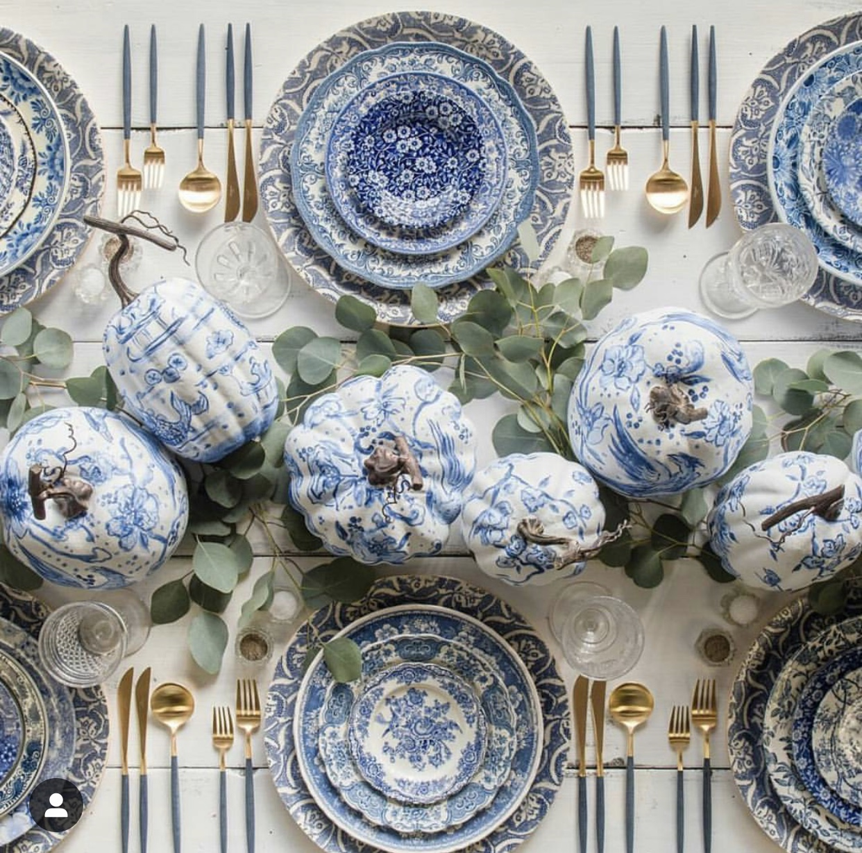 white and blue painted pumpkins on Thanksgiving table