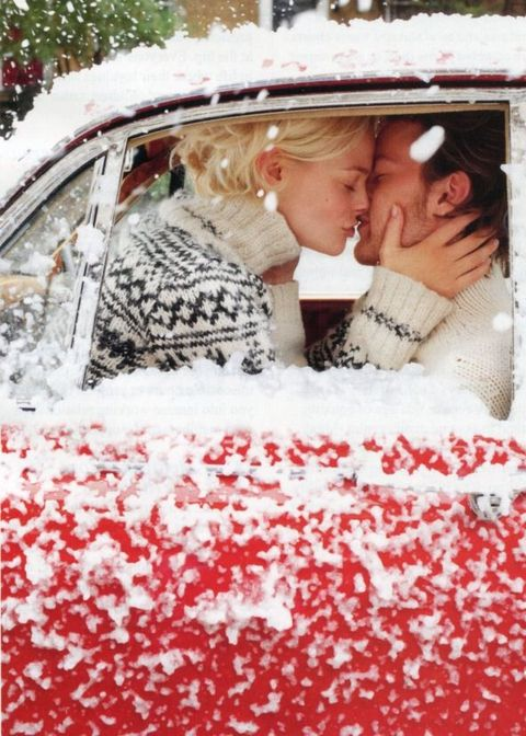couple kissing in vintage snowy car | ROMANTIC WINTER ENGAGEMENT SESSIONS SURE TO MAKE YOU SWOON