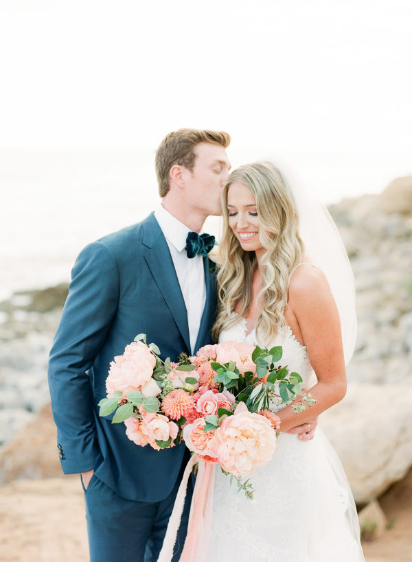 peach peonies bouquet groom with navy suit and velvet bow-tie