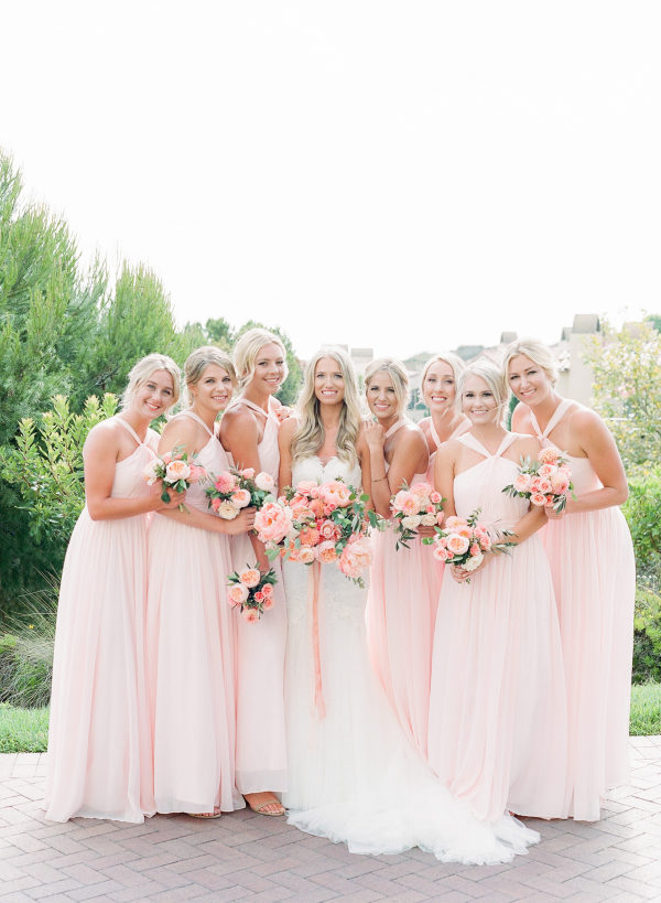 long pink bridesmaids dresses with peach peonies bouquets
