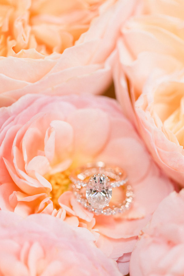 engagement ring on peach peonies