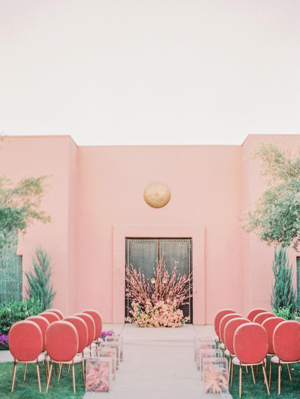 pink velvet ceremony chairs tropical wedding ceremony https://itgirlweddings.com/styled-shoot-with-pink-tropical-wedding-vibes/