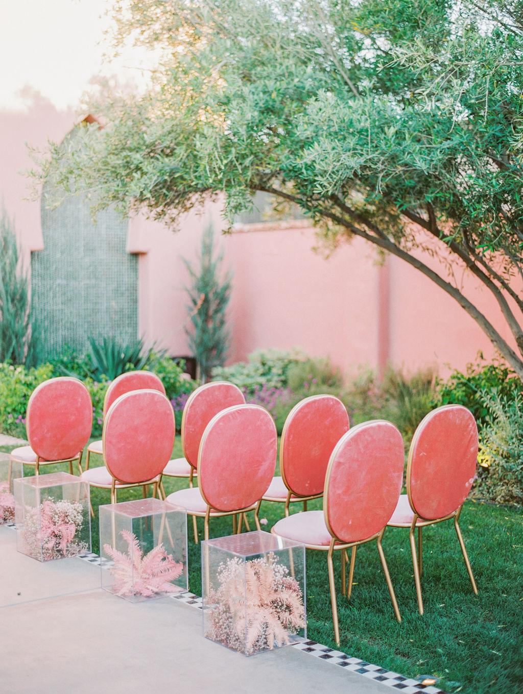 pink velvet wedding ceremony chairs https://itgirlweddings.com/styled-shoot-with-pink-tropical-wedding-vibes/