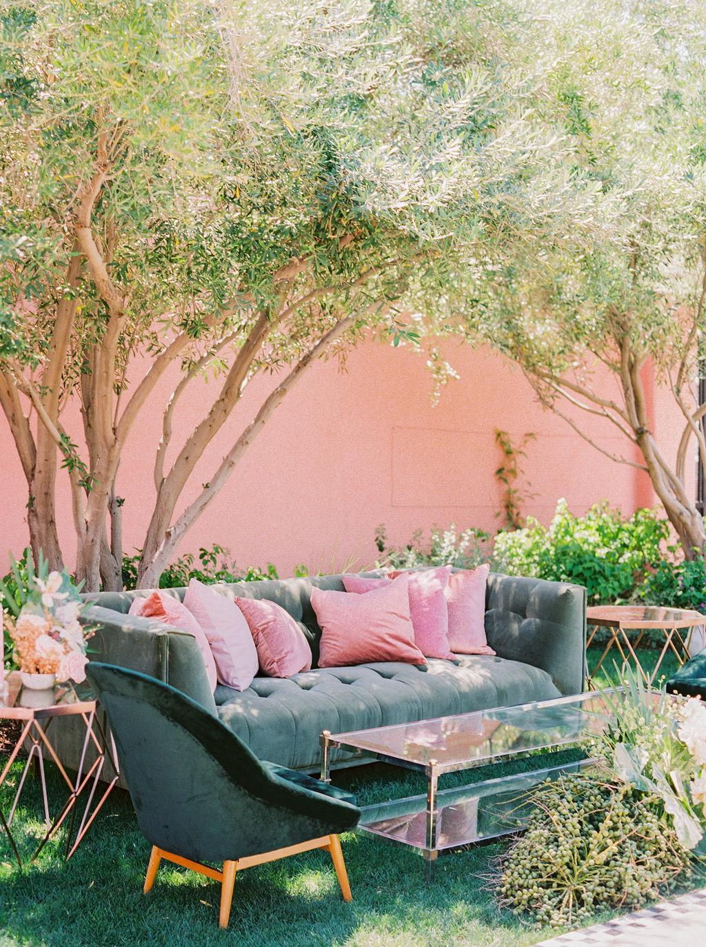 pink pillows and copper wedding cocktail hour furniture https://itgirlweddings.com/styled-shoot-with-pink-tropical-wedding-vibes/