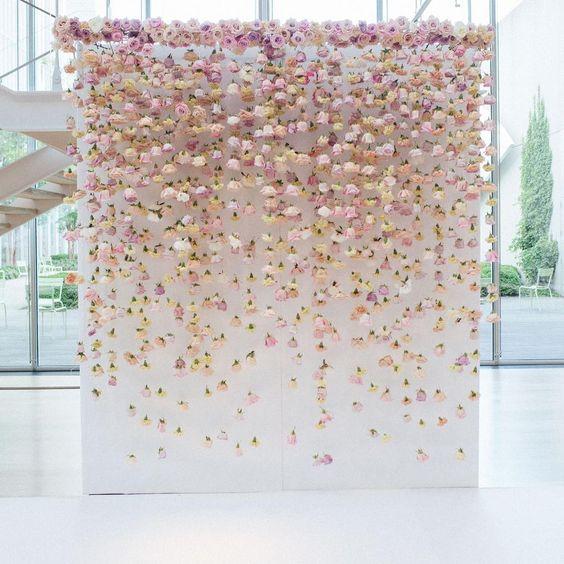 hanging flowers against a wedding photo op wall, wedding floral backdrop https://shopstyle.it/l/bhcoP