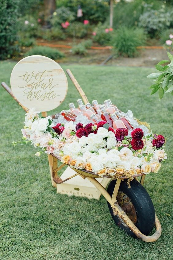 wedding wheelbarrow ice bucket filled with flowers and drinks https://shopstyle.it/l/bhcp9